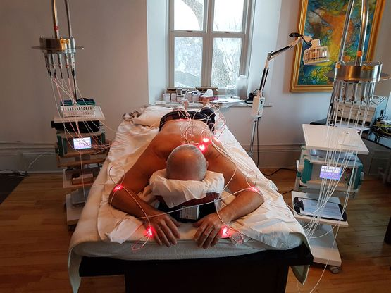 man receiving laser therapy treatment