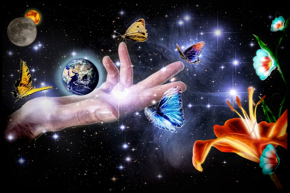 Open hand in space with planets, flowers and butterflies